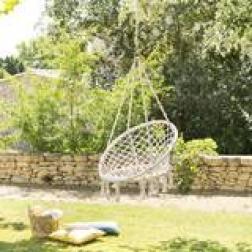 Chaise de détente suspendue en macramé Plumaya